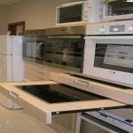 Detalle; mueble extraible para exposición vitrocerámicas